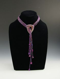Purple Falls    Beaded lariat with polymer clay and sterling silver triangle pendant