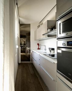Wall mounted oven and microwave leaving room for deep pull out drawers under hob