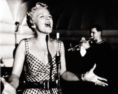 "Peggy Lee. She was a formost Jazz singer and composer of her time. Known dearly to me as Peg, the S. cats, and Darling from ""Lady and the Tramp"". She also took ""Fever"" and made it an anthem that just begged to be sung. Rising out of the ashes in ND, she became one of the most consumate artists of her time."