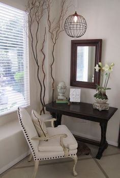 I love this arrangement of an accent table that could double as a desk.  Like the tall branches in the corner and the diy industrial lamp.  instructions in link.