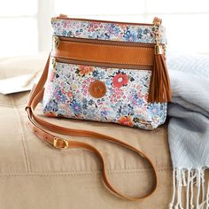 The wildflowers printed on this leather, Italian handbag mirrors those beginning to bloom in spring weather. Fiorentina Travel Bag | National Geographic Store