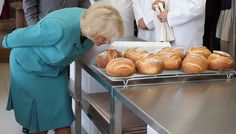 Camilla Parker Bowles Photos Photos - Camilla, Duchess of Cornwall smells freshly baked bread during her tour of the Village Bakery on July 7, 2015  in Wrexham, Wales, United Kingdom. - The Prince of Wales