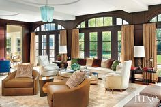 For the great room, Bonner brought in several custom pieces to lend contemporary counterpoints. He then sheathed walls in chocolate-hued wenge panels. Mattaliano Dupré-Lafon Chairs & Madeleine Tables. #interiordesign, #highendfurniture, #instadecor, #designershowroom, #furnituredesign, #customfurniture, #luxuryliving, #loungechairs