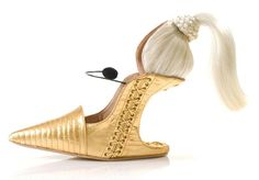 #SHOE_ART by #Kobi_Levi  References the basic shoe form and twists it into a unique, chic art piece that is meant to be displayed.   A sculpture of sorts. 3-D Art.