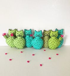 When a cat meets a cactus, adorable things happen... like a Catcus :)   Get this all hand sewn Cactus Cat plushie to adorn your fridge! It will make you smile every day so its the perfect me gift but it can also be a cute gift for the plant lady / cat lady in your life ;)  *********