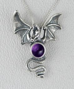 Amazon.com: Sterling Silver Dragon of Protection Accented with a Genuine Amethyst: The Silver Dragon: Jewelry