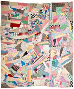 """Crazy Quilt, 1934.  Scrap quilt, 70"""" x 84,"""" made of multi-color cotton fabrics in crazy quilt style. Pieced muslin backing. Applied binding pieced of various fabrics. Marked """"L A A / 6.13.34"""" indicating it was probably made by Leila Ann Axson (Columbia, SC) in 1934.  Image from the Charleston Museum Quilt Collection, held by The Charleston Museum Archives."""