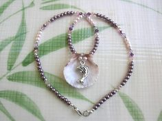 Reversible Seashell Pendant with Dolphin Charm on by CraftySueShop, $25.00