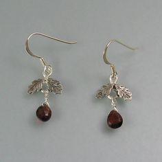 Oak leaf earrings with garnet drops handcrafted from sterling silver by Kryzia Kreations  http://www.kryziakreationsstudio.com/products/acorn-earrings-with-garnets  $85.00