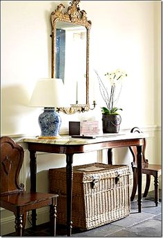 wicker baskets under tables and a china blue lamp. Perfection.