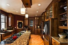 Kitchen design idea with walnut wood cabinetry