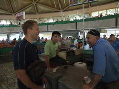 Discussing football with the well informed Chorsu Bazaar vendors