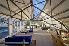 Wonen en werken in oude garageloods - architectenweb.nl