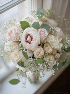 Blush corsage containing Spray Roses, Baby's Breath, and Dusty Miller and topped with a salmon-colored ribbon used to highlight the blush tones and tie together the two spray roses. Description from pinterest.com. I searched for this on bing.com/images