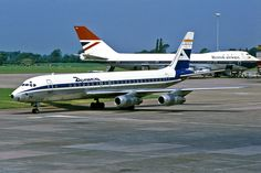 https://flic.kr/p/dyhxAU | Aviaco EC-ATP SORALLA | Aviaco EC-ATP SORALLA, a Douglas DC-8-52 taxies at Manchester International Airport with British Airways G-AWNL, a Boeing 747-136 behind. Saturday 3rd June 1978  Note, EC-ATP was originally operated by Iberia and was purchased by Aviaco on 1st May 1973. G-AWNL was originally owned and operated by the British Overseas Airways Corporation, and was transferred to the British Airways Board on 1st April 1974  Ref no 00597