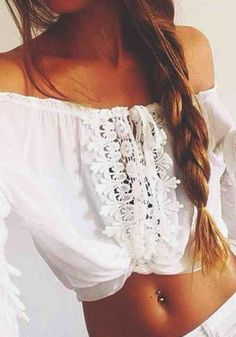 This summer, let this bohemian lace crop top be your new best friend. Cut in delicate floral lace hem with long bell sleeves, an off shoulder neckline, and straps at the front. Achieve a boho look by pairing it with a maxi skirt or a pair of cutoffs and boots. | Lookbook Store Bohemian Style