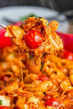 Creamy Pesto Caprese Pasta Casserole Recipe ~ All of the flavors of a caprese salad including tomatoes, basil pesto and plenty of melted mozzarella in a baked pasta casserole