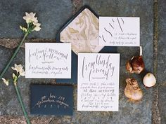 deep envelopes with gold ink, calligraphy, marbled envelope liners