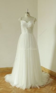 Other A-Line Beaded Cap Sleeve wedding dress currently for sale at 22% off retail.