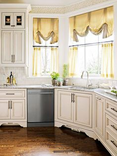 Old-World White- This looks better in larger photo but those curtains make me want to rip them down.  They look tired and dated!  But love these cabinets with the wood floor, my style!