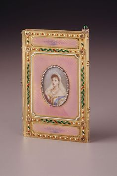 1894-6.  Fabergé notebook with miniature of Empress Alexandra.  Workmaster Mikhail Perkhin, St. Petersburg.  Gold, enamel, diamonds, emerald, watercolour on ivory.   [H 3 15/16 in., W. 2 1/2 in.]
