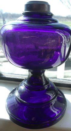 1911 ANTIQUE FOOTED  DEEP PURPLE KEROSENE OIL LAMP 9 X 5 3/4 AMETHYST