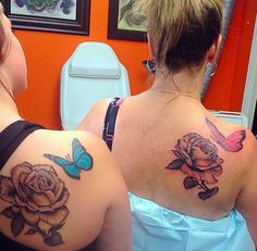 I adore the placement of these tattoos -- a sweet butterfly on their shoulders with a gorgeous rose.