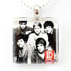 """One Direction Band -- (square) Harry, Zayn, Liam, Niall and Louis Glass Tile Pendant Necklace Jewelry Wearable Art Unique Design By Atlantic Seaboard Trading Co. (square) (1D Gang -- Square) by Atlantic Seaboard Trading Co.. $9.99. Unique Design by Atlantic Seaboard Trading Co.. Packaged in a beautiful organza bag-perfect for gift giving.. Square glass hangs on 17"""" chain. Square glass tile measures 7/8"""" square. Handmade with crystal clear art glass and art on paper, sealed in ..."""