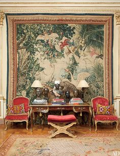 In architect Jorge Elias's São Paulo home, an 18th-century bureau plat stands before a tapestry once owned by Louis XIV. | archdigest.com