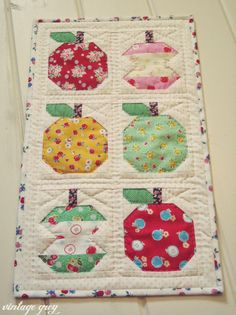vintage grey:: finished patchwork apple mini quilt- quilty fun