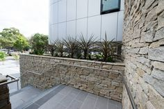 Stone wall cladding is also ideal for fireplaces and areas around outdoor barbecues and water features. #granitecladding #outdoorlife #cladding #sydneybuider #stonecladding #featurewall #outdoorenvirenment #cappingstone