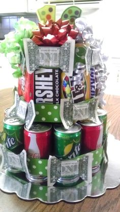 A bouquet of Chocolates, Softdrinks in Can and some money bills. Christmas Gift Ideas for Teenage Boys