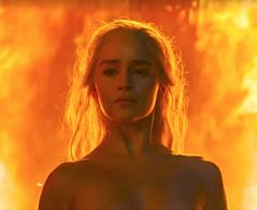 Emilia Clarke as Daenerys the unburnt emerges naked from the flames