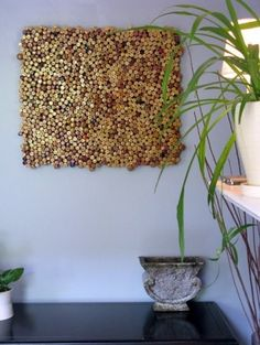This would be neat to try for our wall of fame in the kitchen.  eclectic kitchen wine cork art