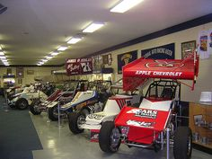 """Here is a row of Sprint Cars from today back to the 60s. They have a lot of beautiful cars there. The top and front wings are more recent additions to the cars. The wings give the cars needed downforce so they can go faster in the turns. These cars r http://advertiseyourbizonline.com Fill Your Autoresponder everytime with the 'Full Meal Deal"""" Social Media Marketing Package."""