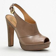 """Brina Heel by COACH:   Dramatic yet refined in smooth, rich leather, this lofty design has a tonal stacked platform and heel and a slender, delicate ankle strap.  Leather  Buckle closure  5"""" heel with 3/4"""" platform  Leather sole"""