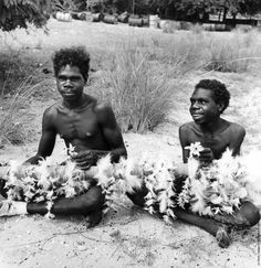 Young aboriginal men from Arnhem Land in the Northern Territory, Australia making magic-ritual sticks which are decorated with feathers. (Photo by Three Lions/Getty Images). Circa 1955