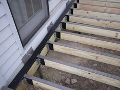 Waterproofing deck framing with Imus Seal deck flashing tape on ledger and Imus Cap on joists Laying Decking, Decking Area, Decking Material, Building Design Plan, Building A Deck, Building Plans, Cool Deck, Diy Deck, Deck Framing