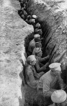 Russian troops awaiting a German attack. This is a typical rear-guard trench, characteristic of the field fortifications of the great retreat. 1917