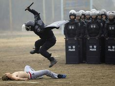 """Chinese National Police SWAT Officer """"Controlling"""" A Pro-Democracy Protestor 
