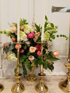 Altar flowers in peach, cream, corals colors.   In bloom, ltd.