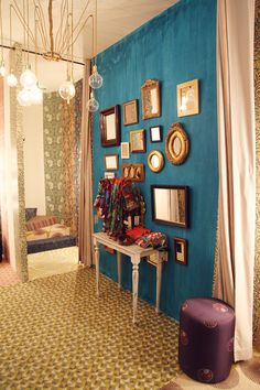 With soft furnished walls and ornate gold frames, we try to add a touch of luxury to our fitting rooms.