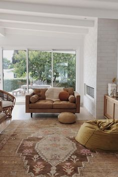 With pieces of furniture this great, you don't need to much to make a statement. A rich leather couch, rattan chairs, and a huge vintage rug complete the space. Photo by Rugs In Living Room, Living Room Furniture, Living Room Decor, Room Rugs, Flat Ideas, Interior Design Inspiration, Vintage Rugs, Rattan Chairs, Lounge