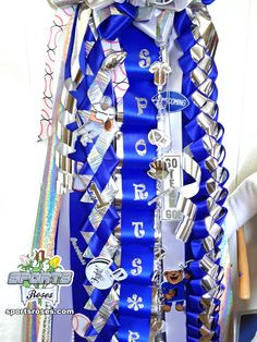 Crafts stores carry tons of accessories like these sports-themed trinkets used on the Sports Roses Homecoming Mum.  Add an extra unique touch from a product not available in stores...Sports Roses.  Order online:  http://sportro.se/mums-garters
