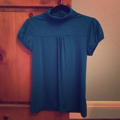 Banana Republic petite blouse This beautiful, soft teal green blouse is made of 59% polyester and 36% rayon. Cute fabric covered buttons at the back of the top give it a classy look. Never been worn with tags on. Banana Republic Tops Blouses