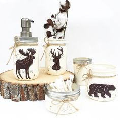 This is one of our customer favorites and is a Midnight Owl Original! Add some rustic charm to your bathroom or kitchen! This 5 piece Ball Mason Jar Set is hand-painted, distressed and sealed with a matte sealant. The moose, deer and bear are hand painted on. The set includes one pint size Mason Jar Soap Dispenser for your choice of soap, lotion, sanitizer, etc. with a stainless steel pump and 4 assorted jar sizes in half pint, pint size (wide mouth), pint, and a 8oz. jelly-jar! Perfect for…