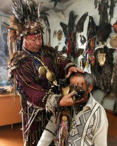 "BEAR MEDICINE:  Kara-ool Dopchun-ool, supreme Shaman of ""The Spirit of Bear"" society, conducts a medical session to cure a man, suffering from asthma and liver disease, at his residence in the Kyzyl, the capital of Tuva Republic in Siberia (Northern Asia), September 13, 2011.  -In Siberia, the Bear is thought to mediate between the living and the dead, as the archetypal messenger to the supernatural world and as a great healer..."
