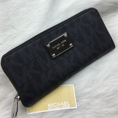 Michael Kors jet set black long continental wallet Brand new authentic Michael Kors wallet with $138 tag attached. Genuine leather. Silver hardware. Nice long billfold style wallet. Silver all around zipper. The tiniest scuffing on the logo which don't even show up in the pictures, only from being on the shelf. An absolute beauty and a classic wallet with plenty of compartments/slots. Measurements are: 8x4.25x1. Michael Kors Bags Wallets