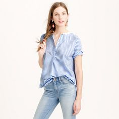 """You know that top that effortlessly makes you look all pulled together? This is it. Striped and structured and ever so slightly tomboyish, you'll be wearing this one with jeans (and skirts, and pants, and...well, you get the idea). <ul><li>Body length: 26 1/2"""".</li><li>Cotton.</li><li>Machine wash.</li><li>Import.</li></ul>"""