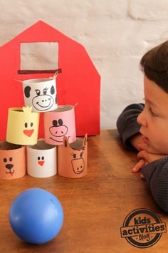 Farm Animal Bowling Game with toilet paper rolls!!  Kids will love this simple game.  Can't wait to use my stash for this.  And, yes..I have a stash...!